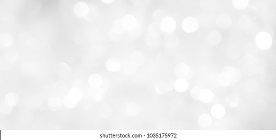 A brilliant blurry white background for a festive mood. Template for greeting card for entertainment.