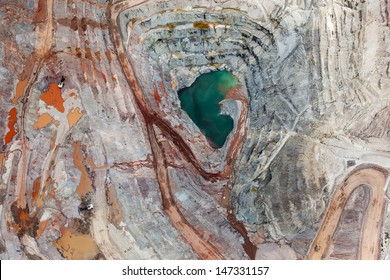 Brilliant colors explode in a vertical view of open pit mining from above
