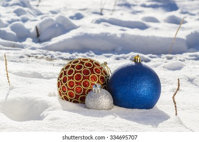 Brilliant fir-tree toys on to snow. Merry Christmas and Happy New Year
