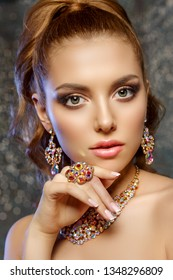 Brilliant. Girl with luxury jewelry. Model with a precious stone. Woman with a diamond.