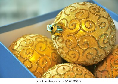 brilliant gold Christmas balls in a box
