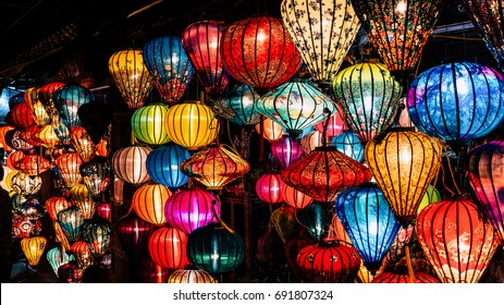 Brilliant lanterns with many colors in old town, Hoi An, Vietnam. Beautiful Traditional vietnamese lanterns at night. Colorful background of handmade lights in typical market in city.