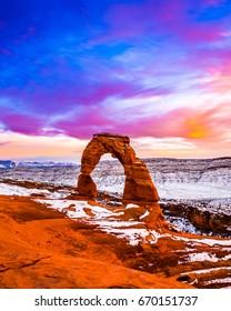 Brilliant Purple Sky over a cold wintery Delicate Arch