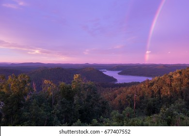 A Brilliant Rainbow at Sunset over Mountain Lake in Broken Bow, Oklahoma
