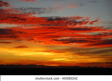 brilliant red and gold colored sunset