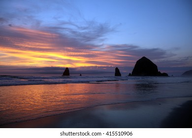 A brilliant sky creates the backdrop for the imposing Haystack Rock in the Pacific Ocean off Cannon Beach on Oregonâ??s northern coastline.