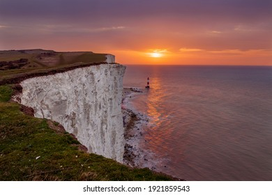 Brilliant sunrise from the cliff edge at Beachy Head East Sussex south east England