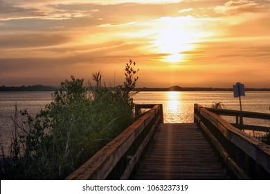 brilliant sunset with boardwalk at Ponce Inlet in New Smyrna Beach Florida
