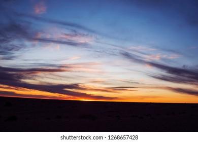 The Brilliant sunset near arid grassland In Inner Mongolia, China.