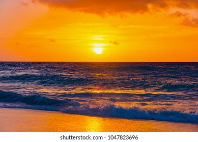 Brilliant vacation destination beach sunrise with colorful sand bright sea foam pink clouds