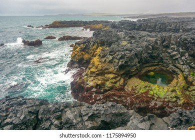 Brimketill naturally carved pool and lava beach in Reykjanes Penninsula, Iceland