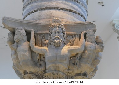 BRINDISI, ITALY - APR 10, 2019 -Tritons and sea gods decorate capital of column marking the end of the Appian way in Roman times,Palazzo Grandfei - Nevegna,Brindisi, Puglia, Italy