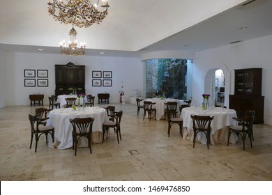 BRINDISI, ITALY - APR 11 2019 - Dining room and lounge built around ancient olive trees at a masseria near Brindisi, Puglia, Italy