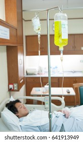 Brine for sick male patient lying in a hospita