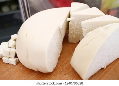 Brine white Cheese. Yellow cheese. Kashkaval. Kashkaval is a type of yellow cheese made of milk . Italian caciocavallo. Gourmet bites of different kinds of cheese background texture.