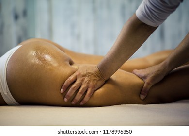 Bring your buttock to perfection. The masseur makes Anti-cellulite massage on the buttock and thighs of the patient. Close up.