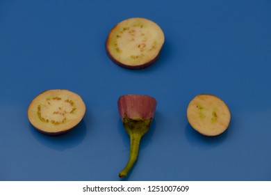 brinjal aubergines slice cut pieces on isolated blue background healthy fresh food vegetables