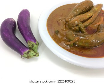 Brinjal curry over white background.
