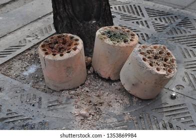 Briquette ash. Seoul KOREA, March 2019. The end of winter. Burnt-out briquettes dumped by the roadside.