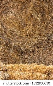 Briquette and bale of straw. Cattle feed for the winter