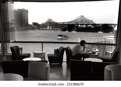 BRISBANE, AUS - SEP 25 2014:A businessman dining in restaurant at Eagle Street Pier.It is an iconic waterfront precinct with world class dining options and unrivaled views of the Brisbane River.