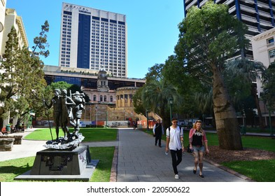 BRISBANE, AUS - SEP 26 2014:Visitors in ANZAC Square. ANZAC Square is a heritage-listed town square located between Ann Street and Adelaide Street in Brisbane, Queensland, Australia.