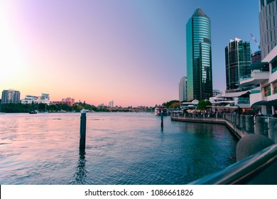 Brisbane, Australia. 19th August 2017 - View of the riverwalk and Eagle Street Pier along the Brisbane River at dusk on 19th August 2017.