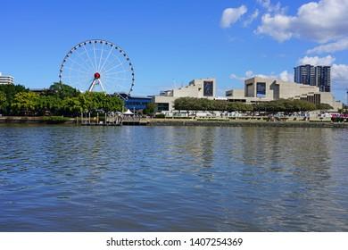 BRISBANE, AUSTRALIA -23 JUL 2018- Waterfront view of the Wheel of Brisbane Ferris Wheel and the QPAC near the South Bank Parklands, City of Brisbane, Queensland, Australia.