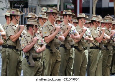 BRISBANE, AUSTRALIA - APRIL 25, 2017: Australian Army soldiers stand to attention at the ANZAC parade.