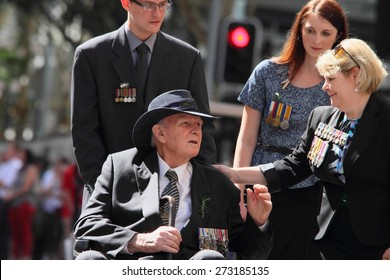 BRISBANE, AUSTRALIA - APRIL 25 : Intergenerational support to older veteran during Anzac day centenary