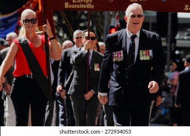 BRISBANE, AUSTRALIA - APRIL 25 : Veterans march along the route during Anzac day centenary commemorations April 25, 2015 in Brisbane, Australia