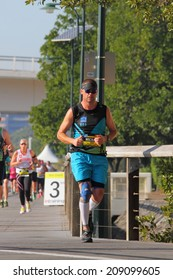 BRISBANE, AUSTRALIA - AUGUST 03 Competitor Michael Ingham and unidentified others in Brisbane Marathon August 03, 2014 in Brisbane, Australia