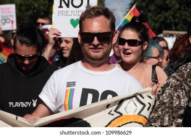 BRISBANE, AUSTRALIA - AUGUST 11: An unidentified man in a gay marriage rights crowd marches in city centre on August 11, 2012  in Brisbane, Australia