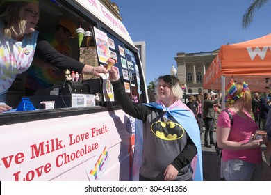 BRISBANE, AUSTRALIA - AUGUST 8 2015: Unidentified rally goer buying gay rainbow ice-cream at Marriage Equality