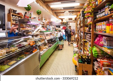 BRISBANE, AUSTRALIA,  CIRCA JUNE 2012: customers shopping in a local deli in Brisbane. Family run small businesses are being wooed by both major political parties in the lead up to the Federal Election.