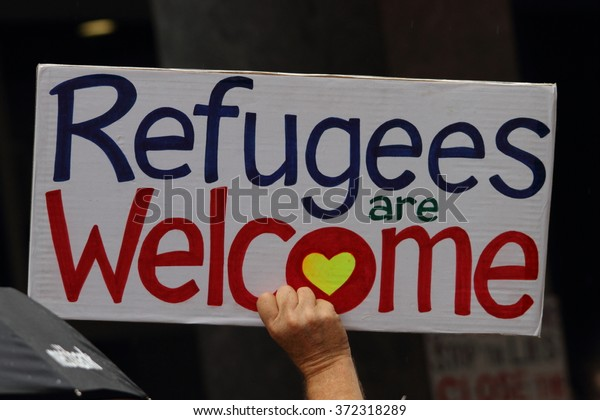 BRISBANE, AUSTRALIA - FEBRUARY 05 : Protest sign in support of churches offering sanctuary to refugees