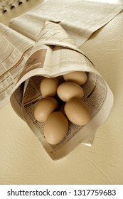 Brisbane Australia February 19, 2019: Uncommon Easter design with eggs in the newspaper cone, sepia image.