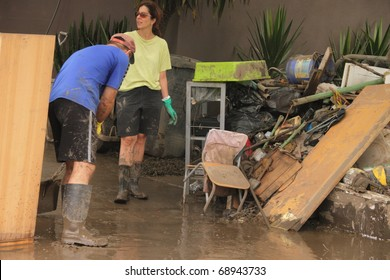 BRISBANE, AUSTRALIA - JAN 14 : Flood  Brisbane Fairfield area community volunteers clean up January 14, 2011 in Brisbane, Australia