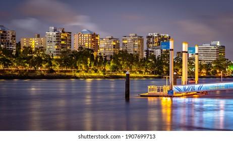 Brisbane, Australia - Jan 31, 2021: Residential apartments at night along the Brisbane river