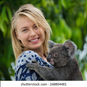 BRISBANE, AUSTRALIA - JANUARY 7: Maria Sharapova poses with a baby koala during the Brisbane International WTA tennis tournament on January 7, 2015