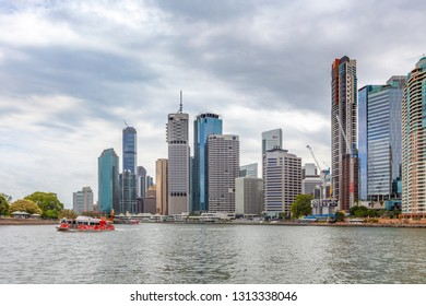 BRISBANE, Australia - January 9 2019: City Hopper ferry sailing on Brisbane river and skyscrapers in the background