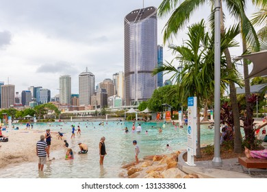 BRISBANE, Australia - January 9 2019: People bathing in Streets Beach inner-city, man-made beach