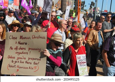 BRISBANE, AUSTRALIA - JULY 06 : Unidentified protesters marching during Bust The Budget anti liberal governement Rally July 06, 2014 in Brisbane, Australia