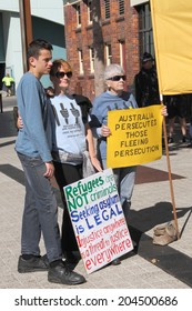 BRISBANE, AUSTRALIA - JULY 12 : Unidentified protesters with anti refugee policy signs outside Liberal National Party national conference July 12, 2014 in Brisbane, Australia