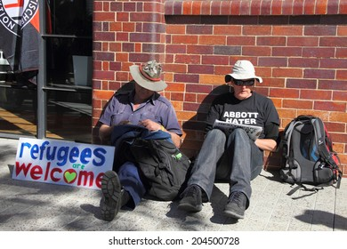 BRISBANE, AUSTRALIA - JULY 12 : Unidentified protesters with anti refugee policy sign outside Liberal National Party national conference July 12, 2014 in Brisbane, Australia