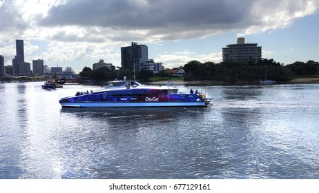 Brisbane, Australia - July 4, 2017 : City Cat Ferry passing by the Mowbray Park in Brisbane River.
