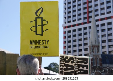 BRISBANE, AUSTRALIA - JUNE 20: Amnesty International placard at World Refugee Day Rally
