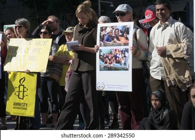 BRISBANE, AUSTRALIA - JUNE 20 :Greens Senator Larissa Waters and others listening to speeches at the World Refugee Rally