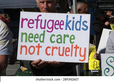 BRISBANE, AUSTRALIA - JUNE 20: Rally goer holding anti- immigration policy at World Refugee Day