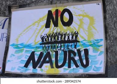 BRISBANE, AUSTRALIA - JUNE 20 : Sign calling for closure of the Naura Island detention center at World Refugee Day